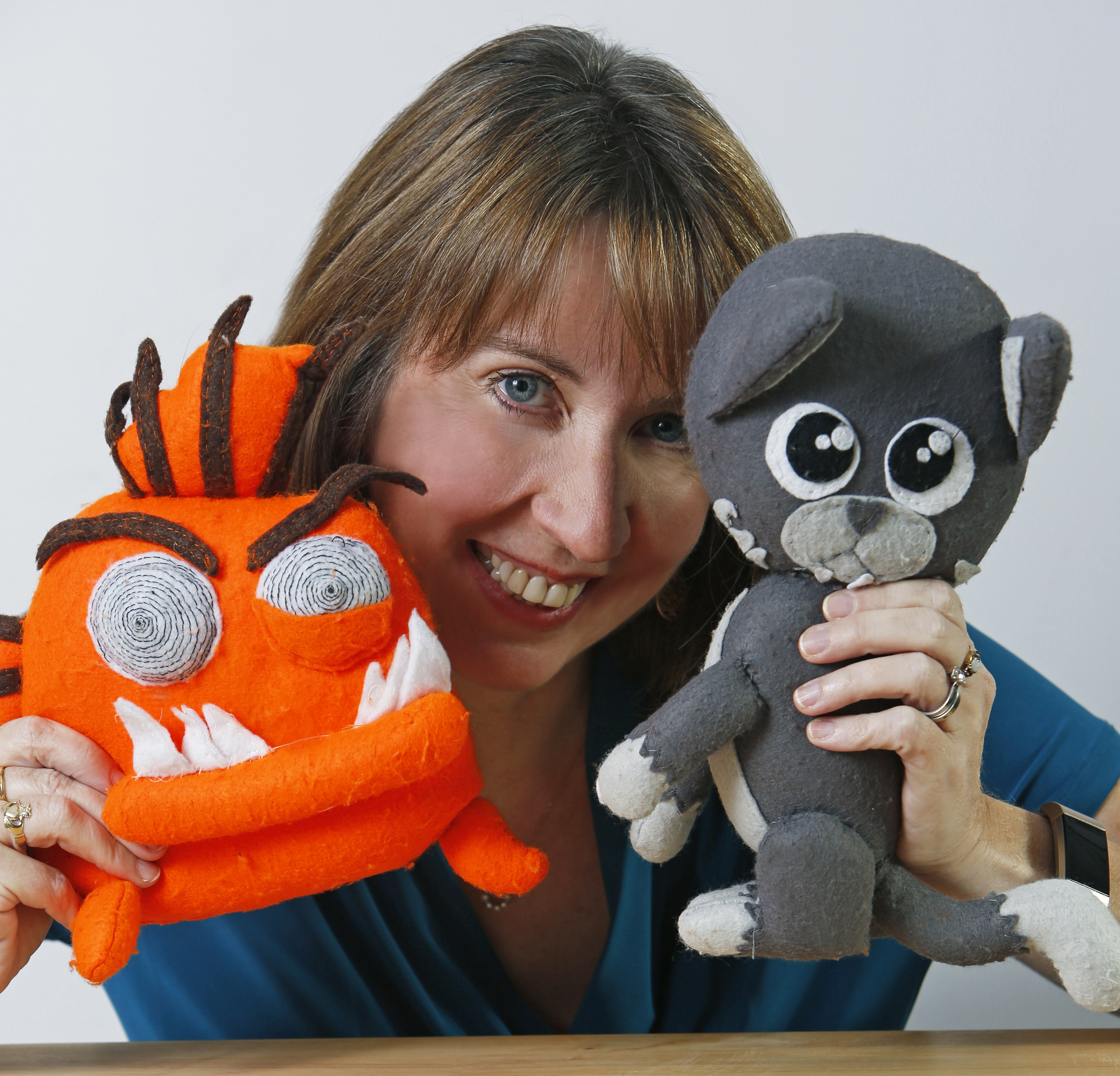 Mo with toys of her book characters